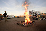 Bobby Estete lighting a fire in the Gold Seekers camp out in California's Mojave Dessert.