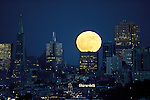 The full moon rises over the San Francisco skyline on the first day of summer seen from Fort Baker in Sausalito.