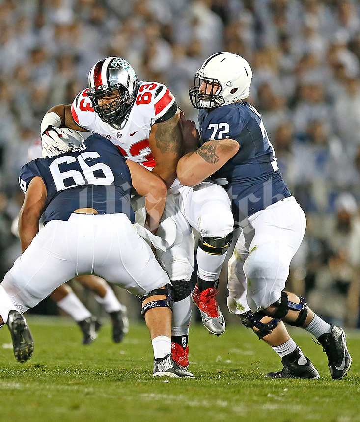 Ohio State Buckeyes defensive tackle Michael Bennett (63) works against Penn State Nittany Lions center Angelo Mangiro (66) and Penn State Nittany Lions guard Brian Gaia (72) at Beaver Stadium on October 25, 2014.  (Chris Russell/Dispatch Photo)