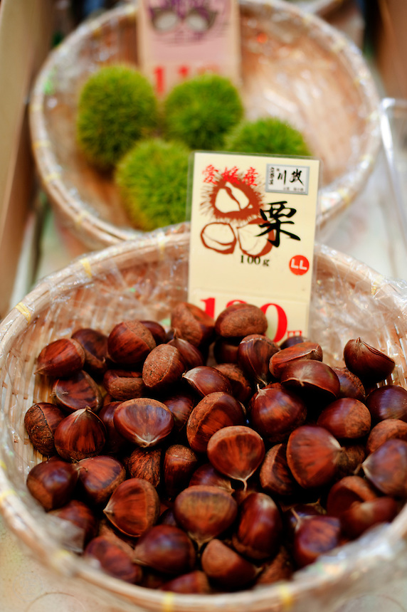 Chestnuts -- both the smooth brown peeled kind and freshly picked fruits in their spiky green casings -- for sale at Kyoto's Nishiki Market.