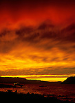 Boat in the Columbia River pulls up to dock under fiery skies