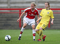 Katerina Doskova of Sparta Prague evades Gilly Flaherty - Arsenal Ladies vs Sparta Prague - UEFA Women's Champions League at Boreham Wood FC - 11/11/09 - MANDATORY CREDIT: Gavin Ellis/TGSPHOTO - Self billing applies where appropriate - Tel: 0845 094 6026