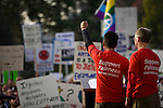 SACRAMENTO, CA - NOVEMBER 22:  Married couple Stuart Gaffney, center, and John Lewis, right, speak in support of gay marriage during a rally on the steps of the State Capitol in Sacramento, California November 22, 2008. People across the country continue to protest the passing of California State Proposition 8 which makes gay marriage in California illegal. (Photo by Max Whittaker/Getty Images)