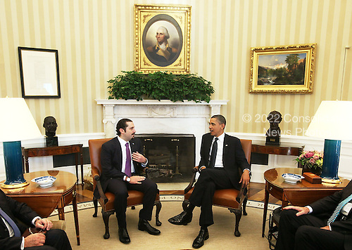 """United States President Barack Obama (R) meets with Prime Minister Saad Hariri (L) of Lebanon in the Oval Office of the White House Wednesday, January 12, 2011 in Washington, DC.  According to a White House media release, the two leaders met """"to discuss U.S. support for Lebanonís sovereignty, independence, and stability, the ongoing work of the Special Tribunal for Lebanon, and other regional issues."""" .Credit: Alex Wong / Pool via CNP"""