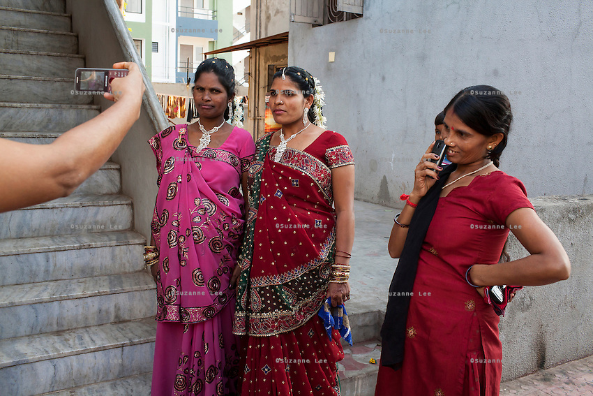 Surrogates get their photos taken after their joint baby shower, organised on the 7th month of pregnancy, in the surrogate's house in Anand, Gujarat, India on 11th December 2012. Photo by Suzanne Lee / Marie-Claire France