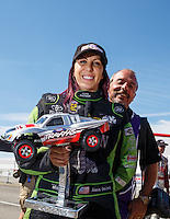 Sep 4, 2016; Clermont, IN, USA; NHRA funny car driver Alexis DeJoria is photo bombed by photographer Gary Nastase during qualifying for the US Nationals at Lucas Oil Raceway. Mandatory Credit: Mark J. Rebilas-USA TODAY Sports