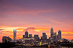A photo of the Charlotte NC skyline as the sun sets behind it.<br />