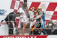 Marc Marquez celebrates with Emilio Alzamora in the Podium