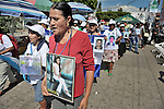 Priscila Cartagena holds a photo of her daughter Yesenia Marleni Gait&aacute;n Cartagena as she walks with a group of Central Americans during a demonstration in the center of Tapachula, Mexico, on December 16, 2013. The group, mostly mothers looking for their children, spent 17 days touring 14 Mexican states in search of their loved ones, most of whom had disappeared while following the migrant trail north. <br /> <br /> Cartagena, who lives in Tegucigalpa, says her daughter migrated north in 2008, headed to the United States, and last called her from Nuevo Laredo, Mexico. She hasn't heard from her since.
