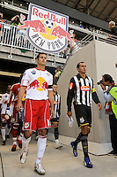 Mike Petke (12) of the New York Red Bulls and Giovanni (10) of Santos FC lead their teams onto the field prior to the start of a friendly between Sanots FC and the New York Red Bulls at Red Bull Arena in Harrison, NJ, on March 20, 2010. The Red Bulls defeated Santos FC 3-1.
