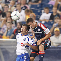 Montreal Impact defender Jeb Brovsky (15) and New England Revolution substitute midfielder Kelyn Rowe (11) battle for head ball. In a Major League Soccer (MLS) match, Montreal Impact defeated the New England Revolution, 1-0, at Gillette Stadium on August 12, 2012.