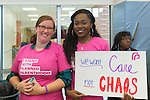 "Westbury, New York, USA. January 15, 2017.  L-R, KARLA BRADLEY, of Hempstead, and NIA ADAMS, of Hempstead, are wearing pink ""I Stand with Planned Parenthood"" T-shirts  and Adams holds sign ""We want Care not CHAOS"" at the ""Our First Stand"" Rally against Republicans repealing the Affordable Care Act, ACA, taking millions of people off health insurance, making massive cuts to Medicaid, and defunding Planned Parenthood. Hosts were Reps. K. Rice (Democrat - 4th Congressional District) and T. Suozzi (Dem. - 3rd Congress. Dist.). It was one of dozens of Bernie Sanders' rallies nationwide for health care that Sunday."