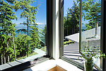 View of the water and snow-capped mountains from a contemporary island cottage. This image is available through an alternate architectural stock image agency, Collinstock located here: http://www.collinstock.com