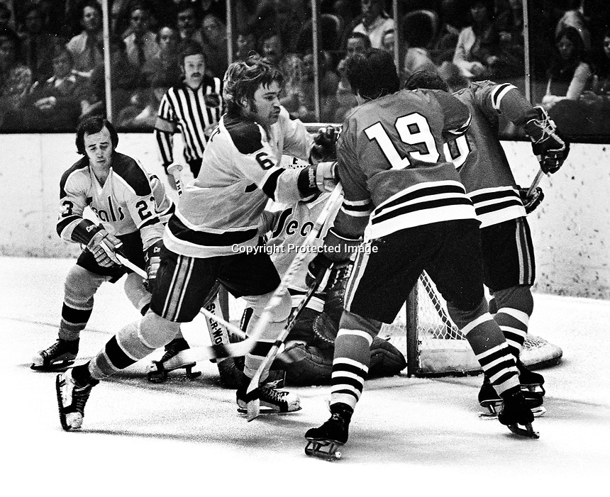 Seals vs BlackHawks,  Bob Stewart and Ted McAneeley protecting his goalie, #19 is Dale Tallon.(1971 photo by Ron Riesterer)