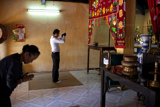 Tourists pray at the Phi Yen Pagoda on Con Son Island, part of the Con Dao Islands.The 16 mountainous islands and islets are situated about 143 miles southeast of Ho Chi Minh City in Vietnam, in the South China. Photo taken Thursday, May 5, 2010...Kevin German / LUCEO For the New York Times