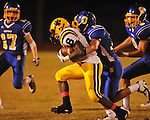 Oxford High's Ethan Holmes (12) makes a tackle vs. Hernando in Oxford, Miss. on Friday, October 14, 2011. Hernando won 31-30 in overtime.