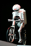 Seisaku-kun, a cycling humanoid robot from Murata Manufacturing Co., is demonstrated in Japan.