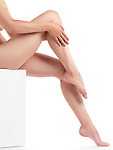 Bare woman legs with smooth skin isolated on white background