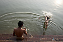 A boy takes a morning plunge into the Ganges River in Varansi, India