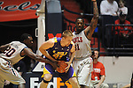 "LSU's Justin Hamilton (41) vs. Ole Miss' Nick Williams (20) and Ole Miss' Murphy Holloway (31) at the C.M. ""Tad"" Smith Coliseum in Oxford, Miss. on Saturday, February 25, 2012. (AP Photo/Oxford Eagle, Bruce Newman).."