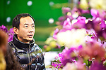 A man shops for orchids in the Jianguo Flower Market (??????) in Taipei, Taiwan.
