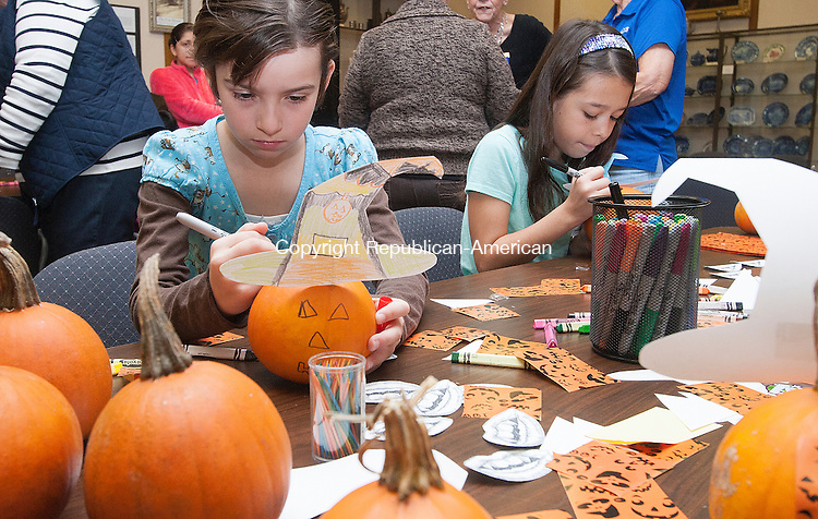 TORRINGTON, CT - 24 OCTOBER 2015 - 102415JW03.jpg -- Jazlyn Patnoe age 8 and Liana Haxo age 11 decorate their pumpkins during Altrusa and the Torrington Library's Fall into Reading Day . Jonathan Wilcox Republican-American