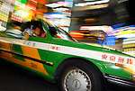 A taxi through a downtown district of Tokyo on Monday 22 October 2007.