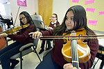 Students play violins during music class in the Lydia Paterson Institute in El Paso, Texas. Most of the school's students travel across the border every day from their homes in Juarez, Mexico, to study at the United Methodist-sponsored high school.