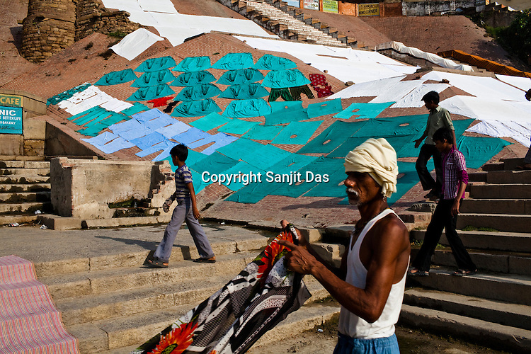 Surgeon and other essential medical clothes are seen drying on the ghats in the ancient city of Varanasi in Uttar Pradesh, India. Photograph: Sanjit Das/Panos