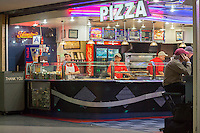 A pizzeria in Penn Station in New York feeds hungry travelers on Saturday, May 10, 2014. (© Richard B. Levine)
