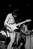 Chicago, Illinois<br /> July 23, 1975<br /> USA<br /> <br /> Guitarist Ronnie Wood of the Rolling Stones performs live at Chicago Stadium during the band's &quot;Rolling Stones Tour of the Americas '75&quot;.<br /> <br /> This was the Stones first tour with new guitarist Ronnie Wood, after Mick Taylor left the band. The Stones, with their usual act freshly aided by theatrical stage props  including a giant inflatable phallus (nicknamed 'Tired Grandfather' by the band, since it sometimes malfunctioned) and, at the Chicago shows, an unfolding lotus flower-shaped stage that Charlie Watts had conceived.<br /> <br /> The band was composed of  Mick Jagger - vocals, guitar, harmonica, Keith Richards - guitar, vocals, Bill Wyman - bass guitar, and Charlie Watts - drums, percussion. <br /> <br /> Additional musicians included: Ronnie Wood - guitar, backing vocals, Ian Stewart - piano, Billy Preston - keyboards, vocals and Ollie Brown - percussion.