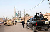 KIRKUK, IRAQ:  An Iraqi Army humvee and a police truck on the streets of Kirkuk...Security is tightened in the volatile Iraqi city of Kirkuk the day before the national elections.  Kirkuk is home to Kurds, Arabs, and Turkmen and has been so violently divided that the city could not participate in the 2005 elections.