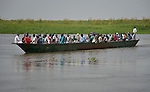 Displaced people return to Bor, a city in South Sudan's Jonglei State that has been the scene of fierce fighting in recent months between the country's military and anti-government rebels. After fighting broke out in mid December 2013, control of the town changed hands four times in a few weeks. ACT Alliance members were among the first humanitarian agencies to enter the city in January 2014, and are providing services to thousands of people who are cautiously returning home to the troubled city. This boatload is arriving from Awerial, on the other side of the White Nile. Many are coming for just one or two days to inspect their homes, many of which were burned and looted, and to evaluate whether they want to commit to returning.