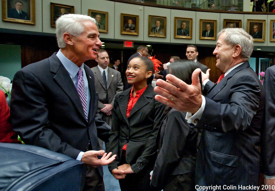 TALLAHASSEE, FLA. 3/2/10-OPENING DAY CH11-Gov. Charlie Crist, left, greets Sen. Michael Bennett, R-Bradenton, right, prior to opening day of the legislature ceremonies, Tuesday at the Capitol in Tallahassee...COLIN HACKLEY PHOTO