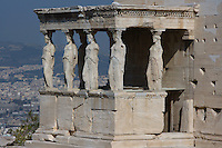 ATHENS, GREECE - APRIL 10 : A general view of the Porch of the Caryatids of the Erechtheum overlooking the city, on April 10, 2007, in Athens, Greece. The Erechtheum was built on the Acropolis, between 421 and 405 BC, in the Ionic Order. The Porch of the Caryatids is on the South side of the Temple and comprises 6 sculptures of maidens bearing libations, in place of columns, standing on a high base and supporting a decorated flat roof. The Caryatids wear a Peplos with a short cloak hanging from their shoulders. (Photo by Manuel Cohen)