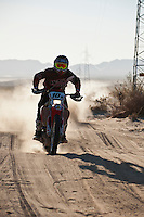 10x Honda motorcycle Ridden by Mark Samuels/Ian Young/Matt Eddy passes race mile 58 in 2012 San Felipe Baja 250, San Felipe, Baja California, Mexico.
