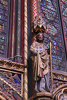 Detail of pillar made of three small columns on each side of a larger central column decorated with golden Castilian castles and flanked by a statue of apostle, nave of the upper chapel of La Sainte-Chapelle (The Holy Chapel), 1248, Paris, France. La Sainte-Chapelle was commissioned commissioned by King Louis IX to house his collection of Passion Relics, including the Crown of Thorns. The Sainte-Chapelle is considered among the highest achievements of the Rayonnant period of Gothic architecture. Picture by Manuel Cohen