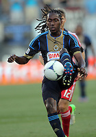 CHESTER, PA - AUGUST 12, 2012:  Keon Daniel (26) of the Philadelphia Union gets the ball in front of  Logan Pause (12) of the Chicago Fire during an MLS match at PPL Park, in Chester, PA on August 12. Fire won 3-1.