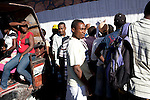 Voters read lists posted outside a polling station to find their voting location for presidential and legislative elections on November 28, 2010 in Port-au-Prince, Haiti.