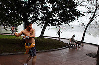 Early morning exercise on a misty morning beside Hoan Kiem Lake, Hanoi, Vietnam.. For a county not know for it's sporting prowess, Hanoi, Vietnam's capital, appears to be gripped in a fitness frenzy. Before 6am street corners, parks and lake sides are a hive of activity as keep fit classes, Tai chi and personal exercise regimes are seen in abundance around the city. Particularly noticeable are Women's keep fit classes, often accompanied by loud poor quality western disco beat music as the occupants of the city get fit come rain or shine. Hanoi, Vietnam. 18th March 2012. Photo Tim Clayton