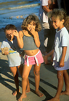 Children of fishermen at beach of fishing village in Alagoas State, Brazil.