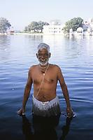 Pandeet, taking his morning bath in Lake Pichola, Udaipur, Rajasthan, India, 2011