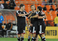 Washington D.C. - May 17, 2014: Fabian Espindola (9) of D.C. United celebrates his score in the 63th minute of the game with teammates Bobby Boswell,Perry Kitchen and Jeff Parke.  D.C. United defeated  the Houston Dynamo 2-0 during a Major League Soccer match for the 2014 season at RFK Stadium.