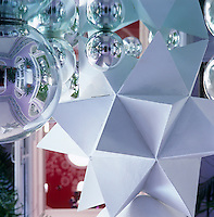 Detail of one of the hand-made polyhedra and some of the reflective glass baubles which can be found throughout the apartment