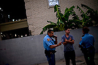 Officers from left, Alberto Cortez Jr. and Claudia Gonzalez listen to a young man's account after a reported domestic dispute on August 19, 2010 in Laredo, Texas. Laredo has been beefing up its police force to deal with the possibility of spillover violence, but crime remains relatively low with only six murders this year. City officials say negative attitudes about the city's more dangerous sister Nuevo Laredo have kept tourists from coming and effected the over all economics of the town.