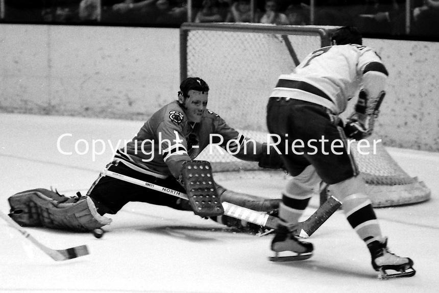Seals vs Chicago Black Hawks 1970. Seals Earl Ingarfield against Black Hawks goalie Gerry Desjardins. (1970 photo/Ron Riesterer)