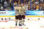 07 APR 2012:  Bill Arnold (24) and Tommy Cross (4) of Boston College celebrate their victory against Ferris State University during the Division I Men's Ice Hockey Championship held at the Tampa Bay Times Forum in Tampa, FL.  Boston College defeated Ferris State 4-1 to win the national title.  Matt Marriott/NCAA Photos