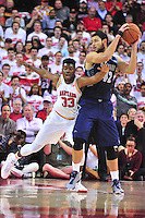 Diamond Stone of the Terrapins tries to poke the ball away from Hoyas Bradley Hays. Maryland defeated Georgetown 75-71 during a game at Xfinity Center in College Park, MD on Wednesday, November 17, 2015.  Alan P. Santos/DC Sports Box