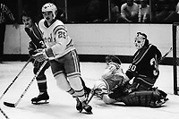 Seals Al MacAdam with Kansas City Scouts Dennis Patterson and goaiie Bill McKenzie (1975 photo by Ron Riesterer)