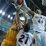 Delaware Forward Jamelle Hagins (44) blocks George Mason Forward Marko Gujanicic (40) shot attempt in the second half of a regular season NCAA basketball game against George Mason Saturday, March 2, 2013 at the Bob Carpenter Center in Newark Delaware.